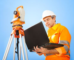 Land surveyor with theodolite